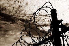 Prison Fence Against Dark Sky Stock Photography