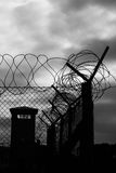 Prison fence and Watchtower Royalty Free Stock Photo