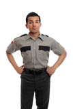 Prison guard or policeman. Prison guard, warden, or cop standing firm with hands on hip stock photography