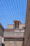Prison guard tower from below. Prison guard tower and wire on top of the yard to prevent escaping royalty free stock image