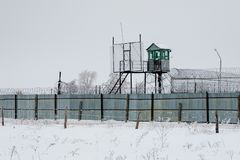 Prison guarding tower, fence with barbed wire.  royalty free stock image