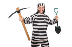 Prison inmate with axe and spade Royalty Free Stock Image