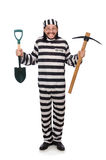 Prison inmate with axe and spade Stock Photography