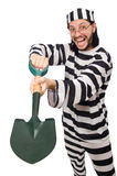 Prison inmate with spade isolated on white Stock Images