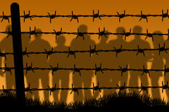 Prison. People being imprisoned behind barbed wire Royalty Free Stock Images