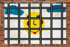 Prison's window with bars and children's drawing Royalty Free Stock Image