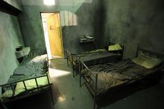 Prison. Three bads in a bad condition prison cell Stock Photography