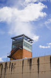 Prison tower. Of public prison building and cloudy sky royalty free stock image