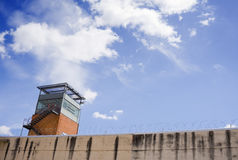 Prison tower. Of public prison building and cloudy sky stock photo