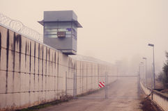 Prison tower and wall. In fog day stock photos