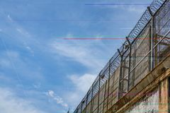 Prison wall. Against of blue sky with clouds, freedom concept, cell, jail, corridor, bar, penitentiary, justice, criminal, old, building, crime, interior royalty free stock photos