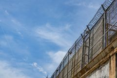 Prison wall. Against of blue sky with clouds, freedom concept, cell, jail, corridor, bar, penitentiary, justice, criminal, old, building, crime, interior royalty free stock photo