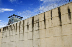 Prison wall. And barbed wire stock photos
