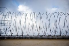 Prison. Wall with barbed wire in Poland Stock Photo