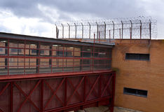 Prison wall and bridge Stock Photography