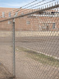 Prison wall and prison building. Prison fence and prison building Royalty Free Stock Images