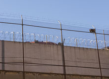 Prison warb wire. Prison wall and barb wire close up Stock Photo