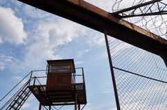 Prison watchtower and Barbed wire. Prison watchtower and a piece of Barbed wire Royalty Free Stock Images