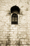 Prison Window. Lonely prison window on a high wall Royalty Free Stock Photography