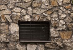 Prison window with bars. In a stone cave royalty free stock image