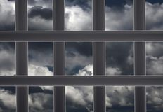 Prison window cell and cloudy sky Stock Photography