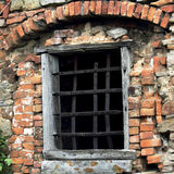 Prison window of a medieval castle Royalty Free Stock Photography