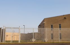 Prison Yard. Double fenced with barbed wire prison yard Stock Images