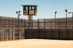 Exterior Prison Yard Empty with guard tower. Exterior horizontal shot of desert prison yard with a guard tower in the background stock photos