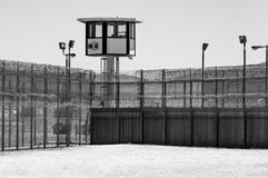 Prison Yard Empty with guard tower in black and white. Exterior black and white vertical shot of prison yard with guard tower stock photography