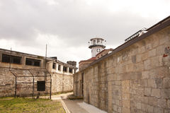 Prison Yard and Guard Tower Stock Photos