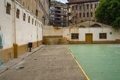 Prison yard with playground. Cell, jail, corridor, bar, penitentiary, justice, criminal, old, building, crime, interior, security, metal, prisoner, punishment stock photo