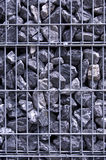 Prisoned stones Stock Images