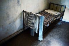 Prisoner bed and uniform Royalty Free Stock Image