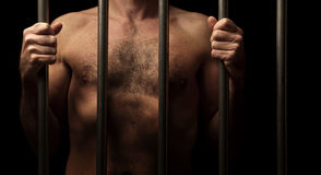 Prisoner behind bars Royalty Free Stock Images