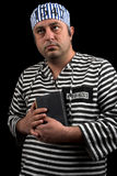 Prisoner with book Royalty Free Stock Photography