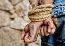 Prisoner bound with rope stock photos