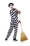 Prisoner with broom Royalty Free Stock Images