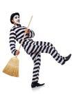 Prisoner with broom Stock Photo