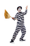 Prisoner with broom. Isolated on the white royalty free stock photography