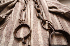 Prisoner Clothes And Chains Royalty Free Stock Photo