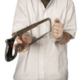 Prisoner cutting off handcuffs Stock Photo