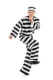 Prisoner escaping. Isolated on white background Royalty Free Stock Photography
