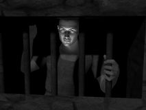 Prisoner gazing through bars. Man looks out from a barred window – concept image that could be used to represent, for example, debt as well as the more obvious Royalty Free Stock Photography