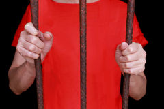 Prisoner grab a bar in a jail Royalty Free Stock Photos
