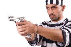 Prisoner with gun Royalty Free Stock Photo