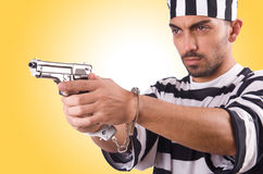 Prisoner with gun isolated Royalty Free Stock Images