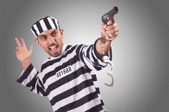 Prisoner with gun  Royalty Free Stock Photography