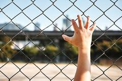 Prisoner hand holding iron bar Royalty Free Stock Image