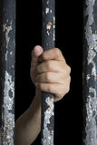 Prisoner hand holding iron bar Royalty Free Stock Photo