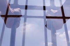 Prisoner holding bars in the jail Stock Photography